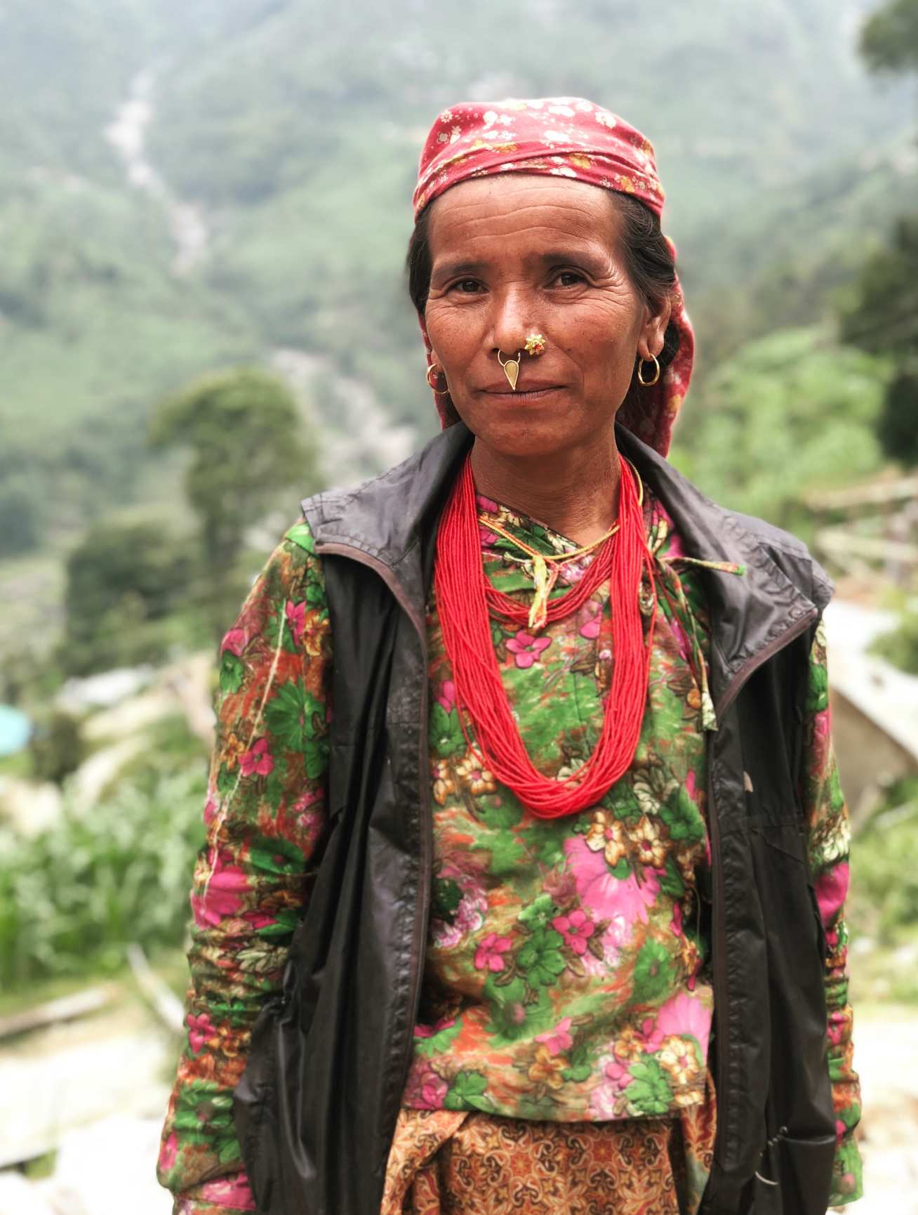 A Nepalese lady in front of landscape