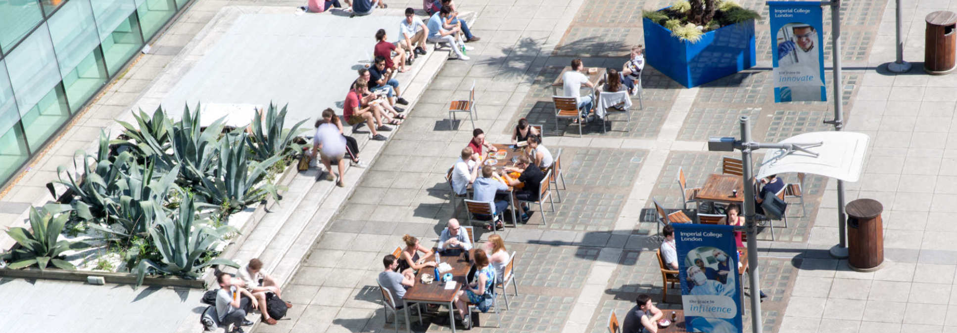 Image of people relaxing on Dalby Court at Imperial College London