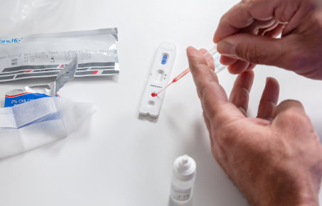 A person using a home coronavirus antibody test