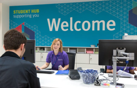 image of student hub reception with staff