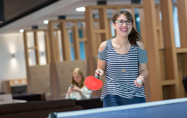 Student playing table tennis in halls