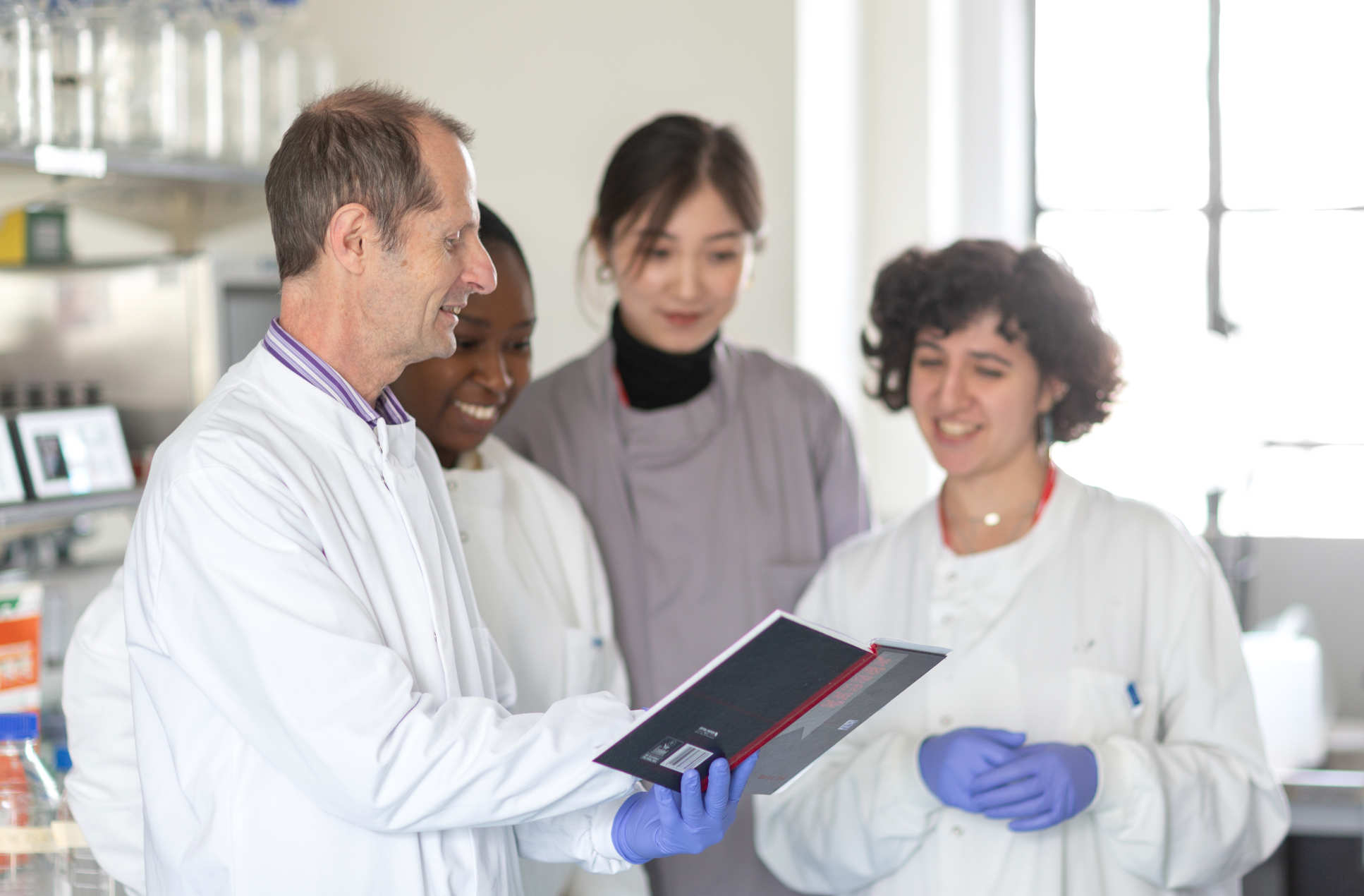 Professor Robin Shattock and team, working in the lab to develop a coronavirus vaccine.