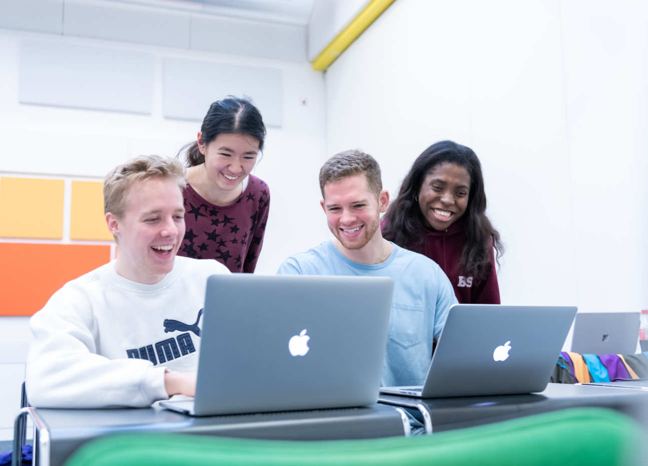 Applied Computational Science and Engineering MSc students working together on laptops
