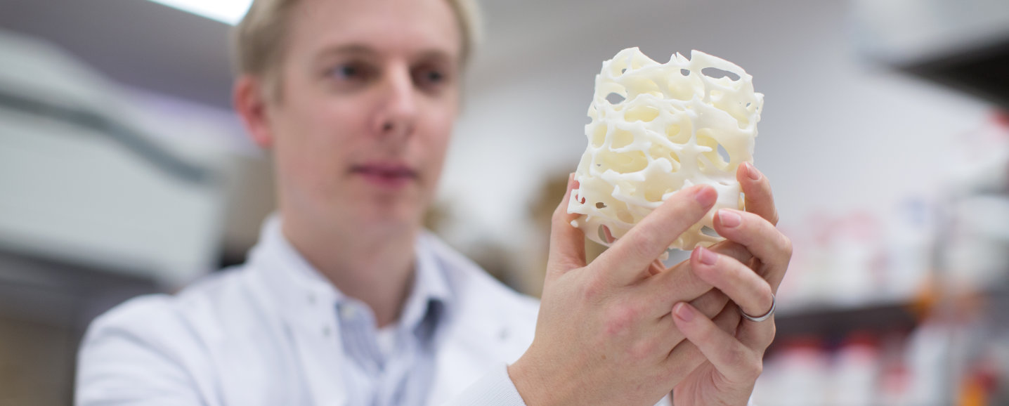 An image of Julian Jones holding the first 3D porous scaffold made from bioactive glass