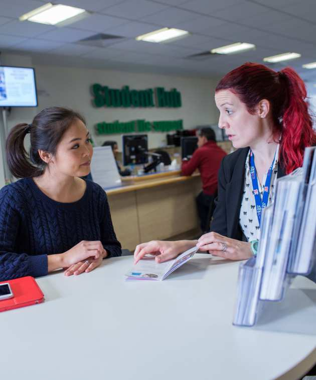 Student getting advice at the Student Hub