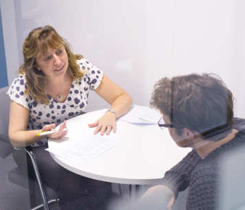 A Careers Consultant interviews a student.