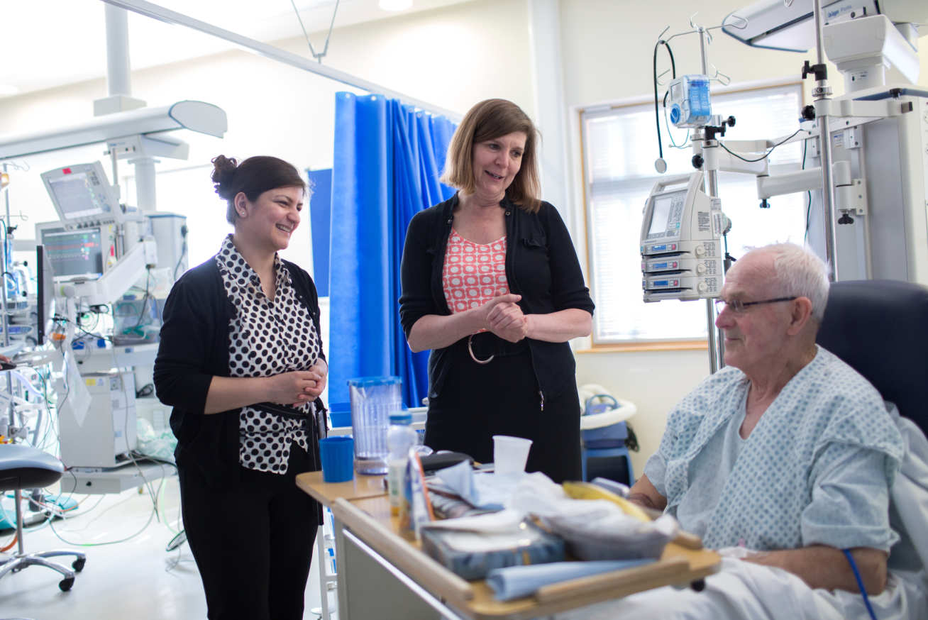 Professor Alison Holmes, Professor of Infectious Diseases, and Associate Medical Director at Imperial College Healthcare NHS Trust with a patient at Hammersmith Hospital