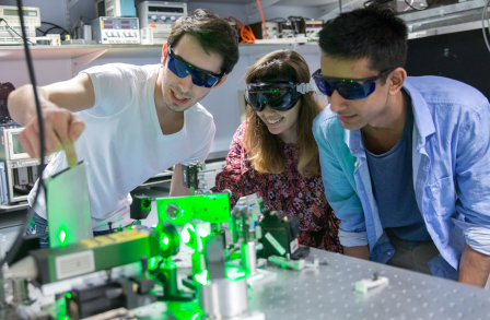 Undergraduate President's scholars working with lasers in the Blackett Laboratory