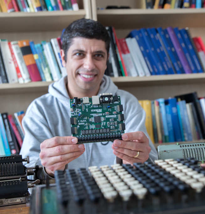 Professor George Constantinides holding computer chip