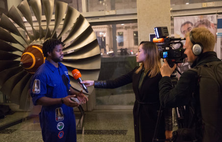 Man being interviews by TV crew