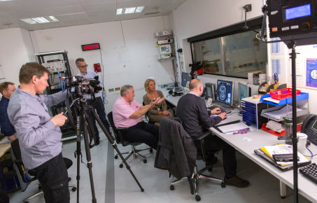 A TV crew filming some researchers