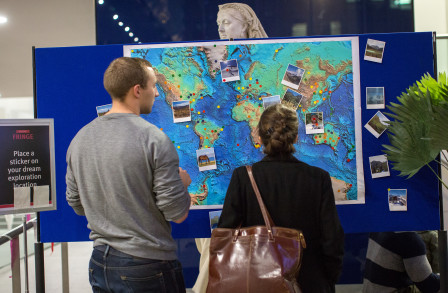 Members of the public look at a map at our Around The World Fringe