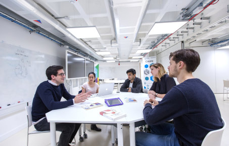 Meeting taking place with five people in the Enterprise Lab