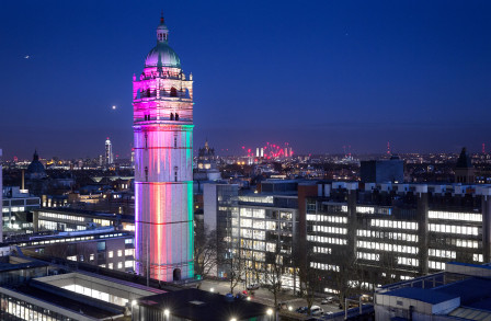 Queens Tower lit up in rainbow colours