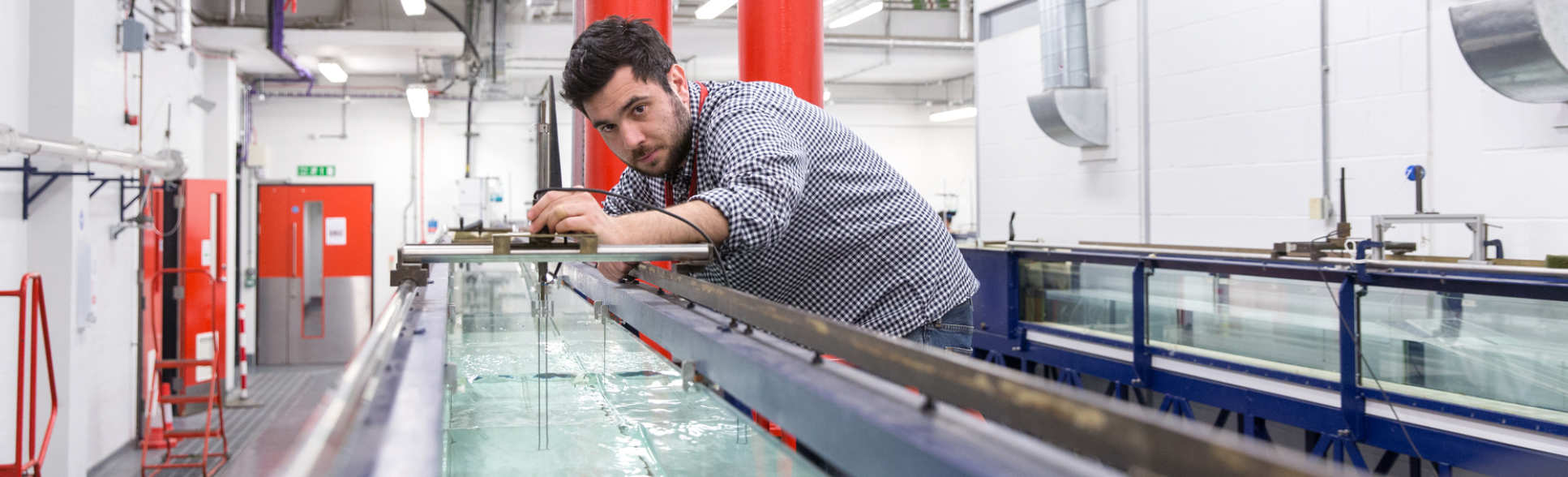 PG student Ioannis Karmpadakis preparing a wave demo for MSc students in the Fluid Mechanics Lab