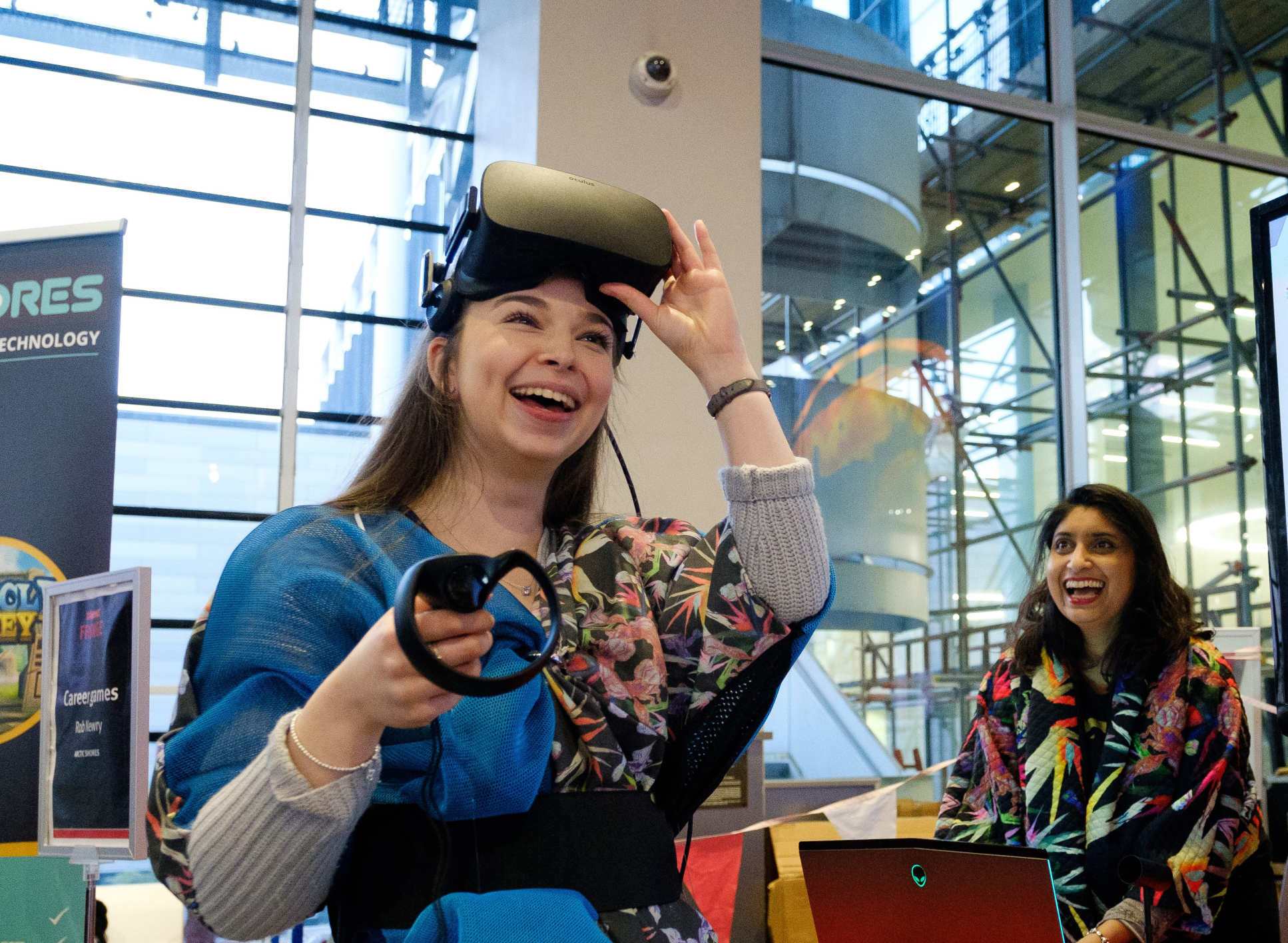 Woman wearing patterned coat and virtual reality headset