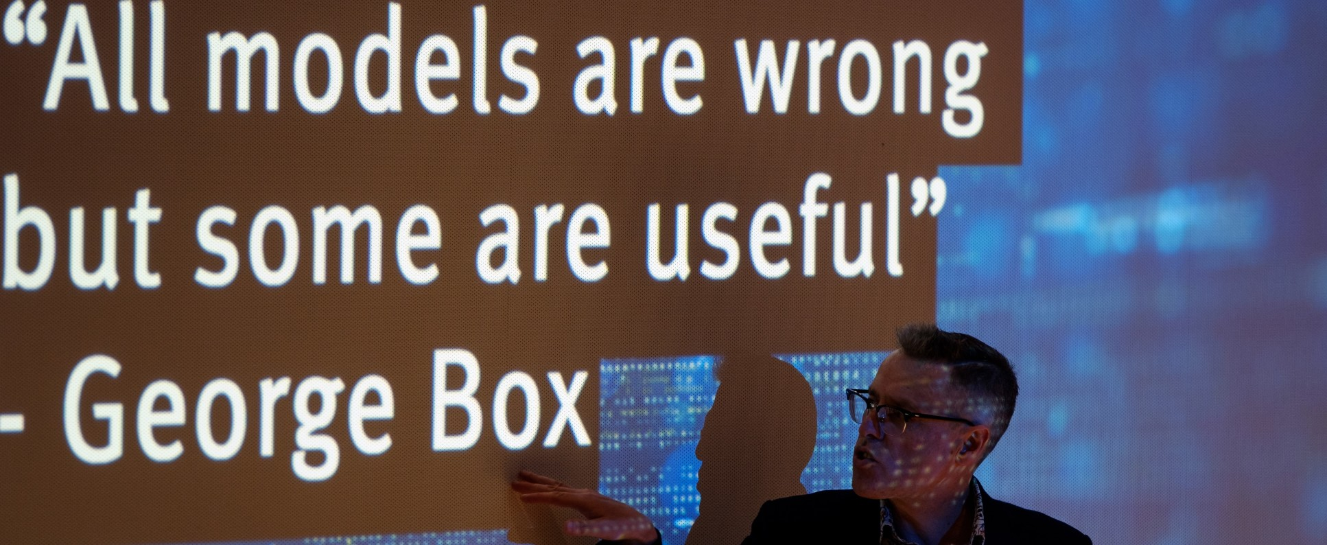 Person in front of a screen that reads 'all models are wrong, but some are useful' - George Box
