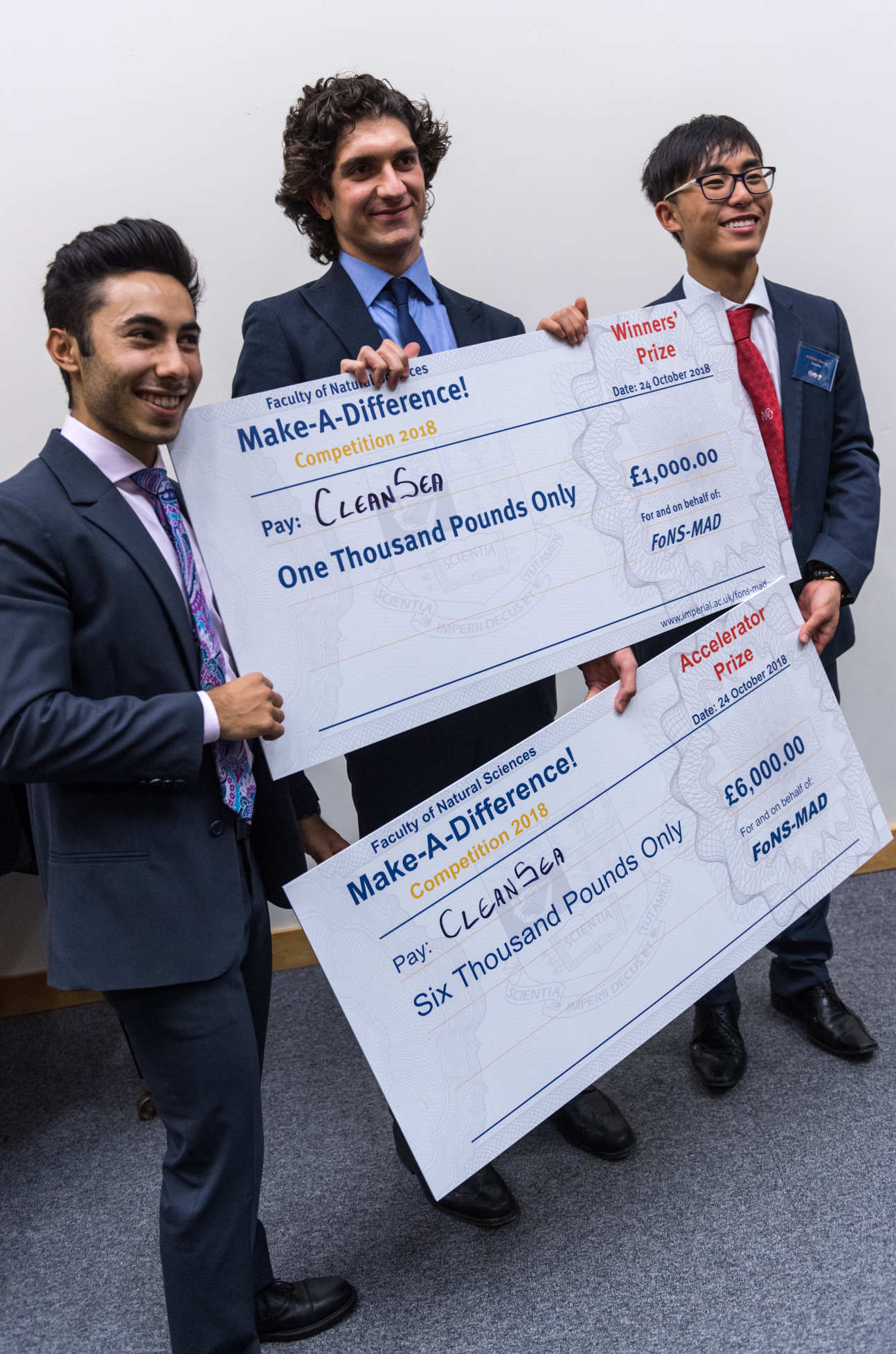CleanSea with two giant cheques