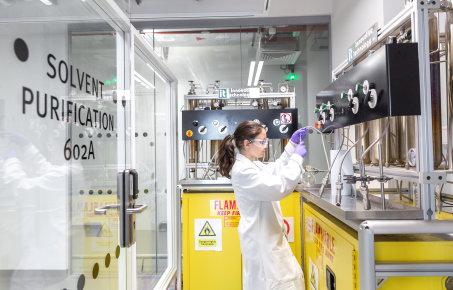 Research student dispensing dry solvents from the solvent towers in the Molecular Science Research Hub (MSRH)