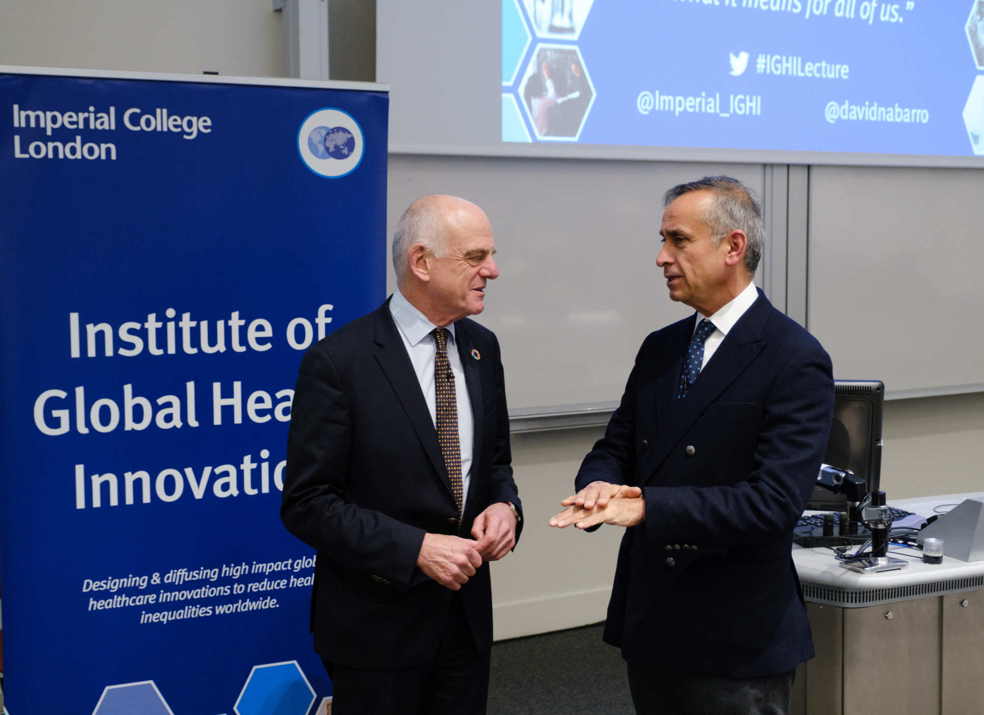 Dr Nabarro and Prof Darzi in discussion at a lecture