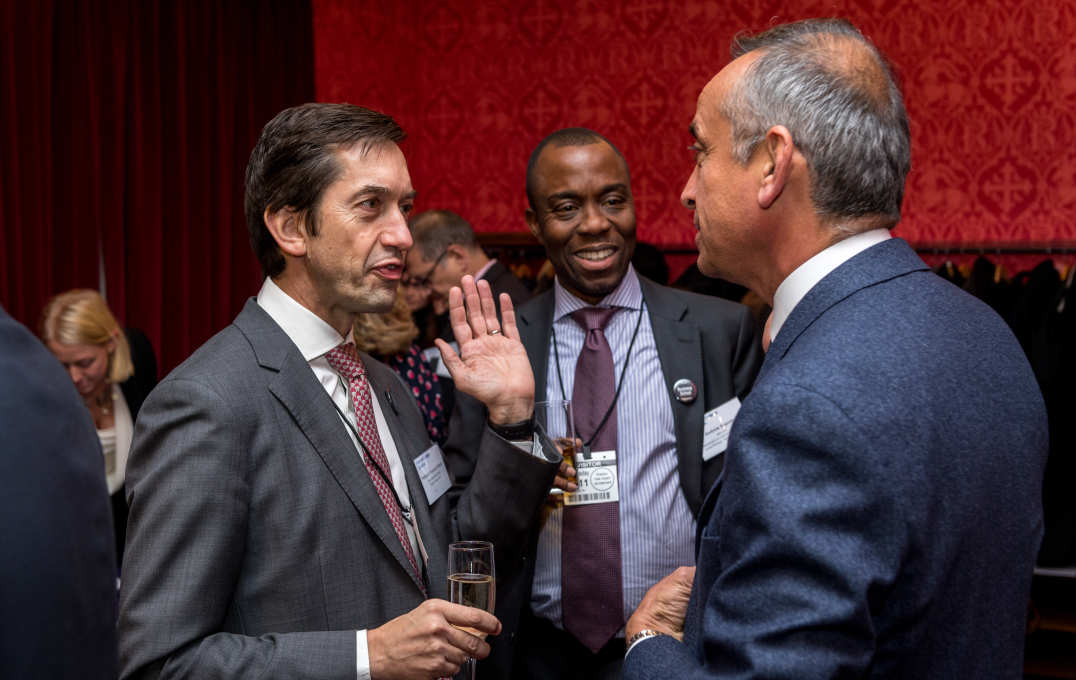 Dean Franciso Veloso talks to alumni and Lord Darzi