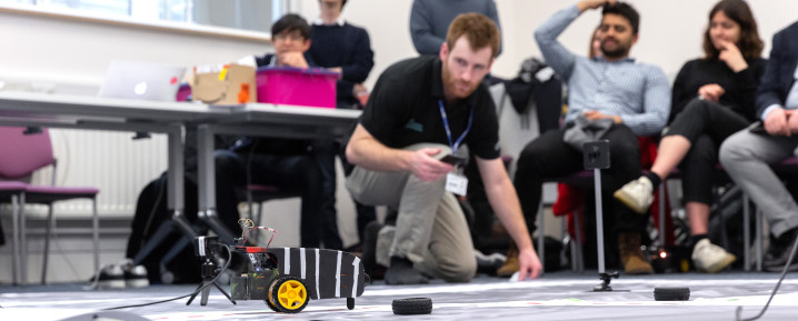 Bioengineering student looking at robot before race