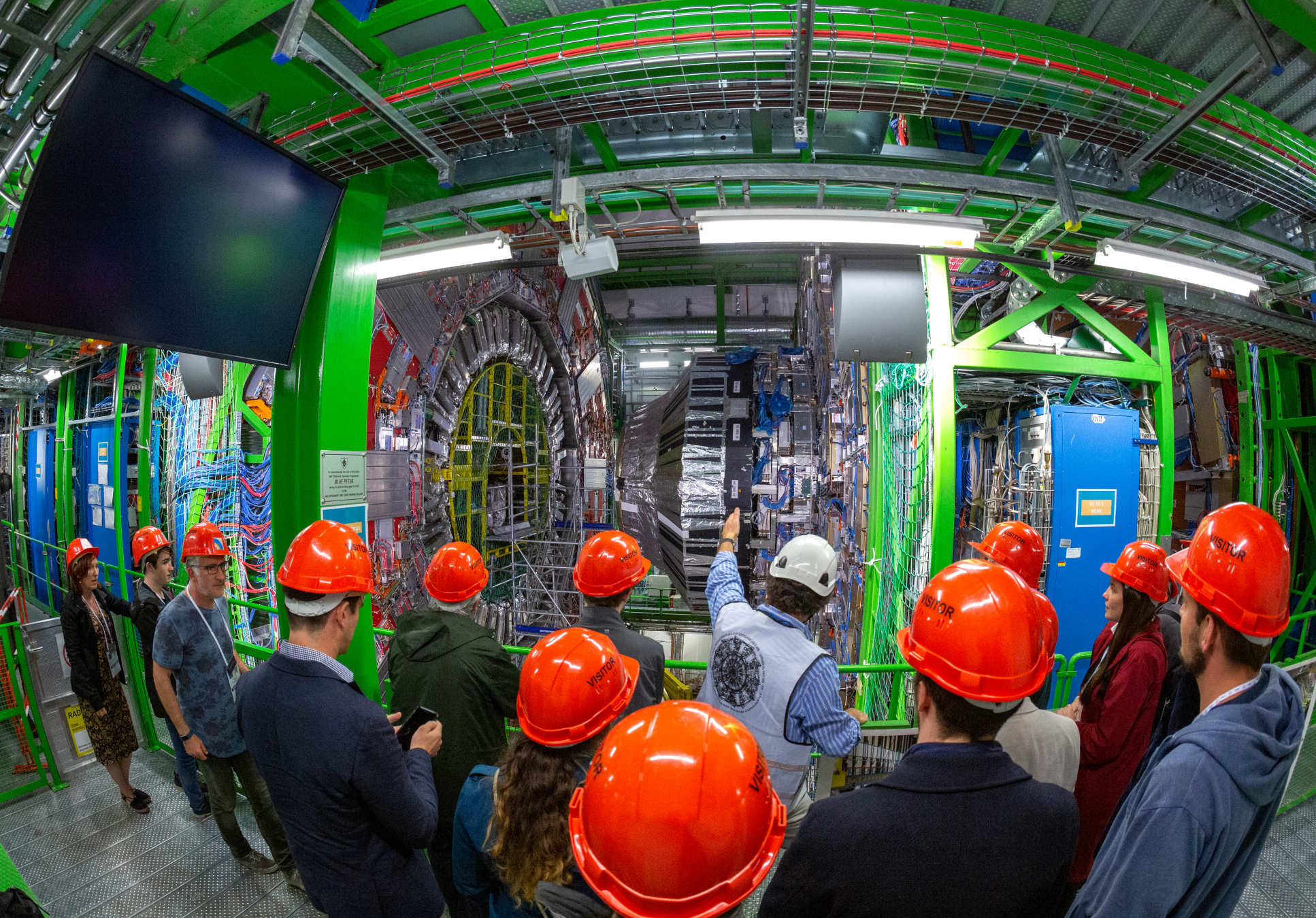 Alumni looking at the Large Hadron Collider