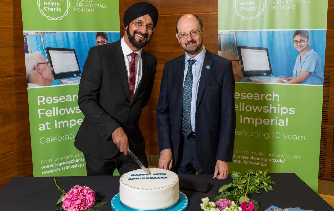 Professor Waljit Dhillo and Mr Ian Lush, Chief Executive of Imperial Health Charity, cut a special cake to mark the 10th anniversary of the Imperial Research Fellowships programme