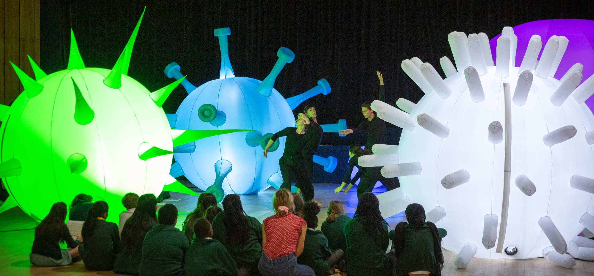 Children watch a science-inspired dance performance
