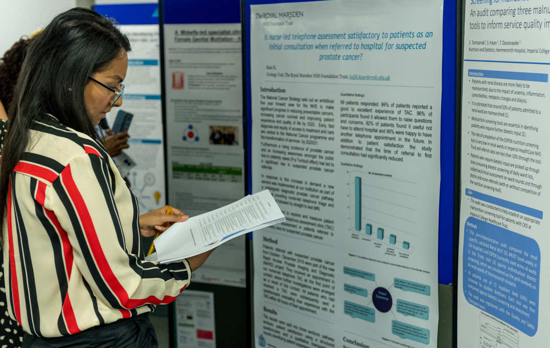 Delegates view research posters carried out by their peers