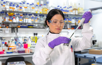 Researcher in Life Sciences lab
