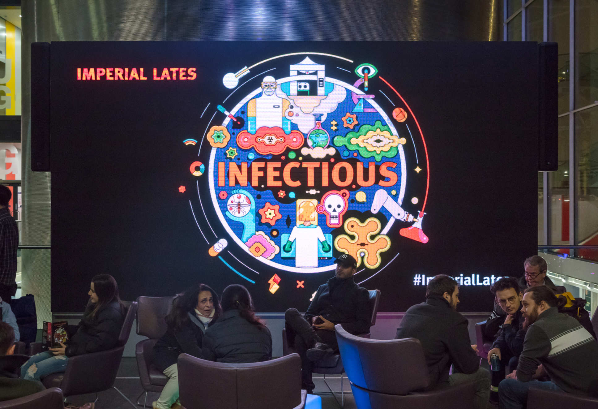 The Imperial Lates: Infectious logo on a big screen in the College's main entrance