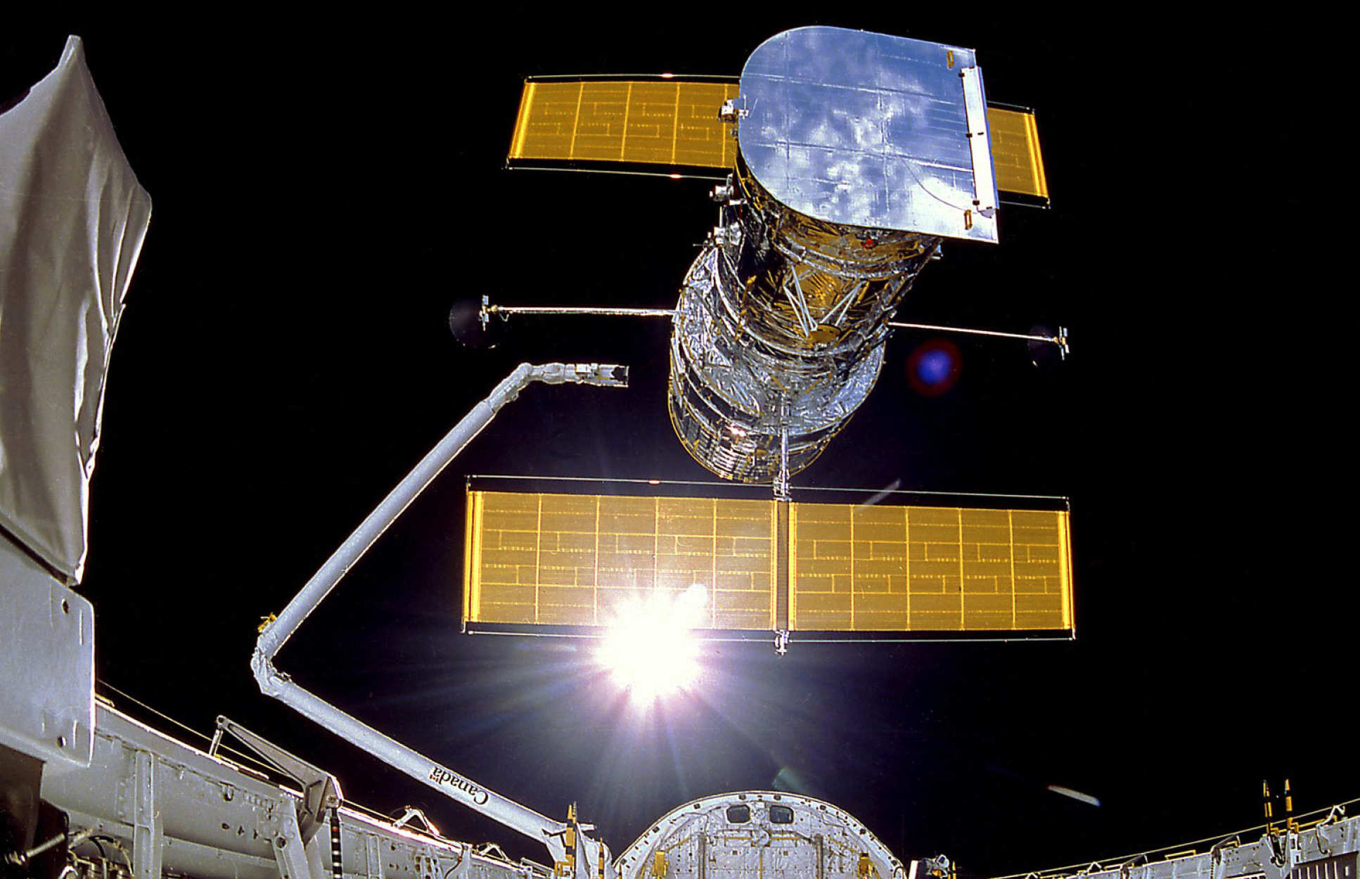 The deployment of the Hubble Space Telescope in April 1990