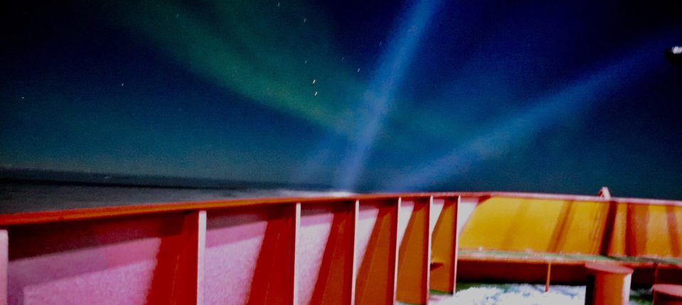 Aurora Australis and search lights