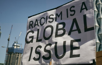 A banner sating 'Racism is a global issue'