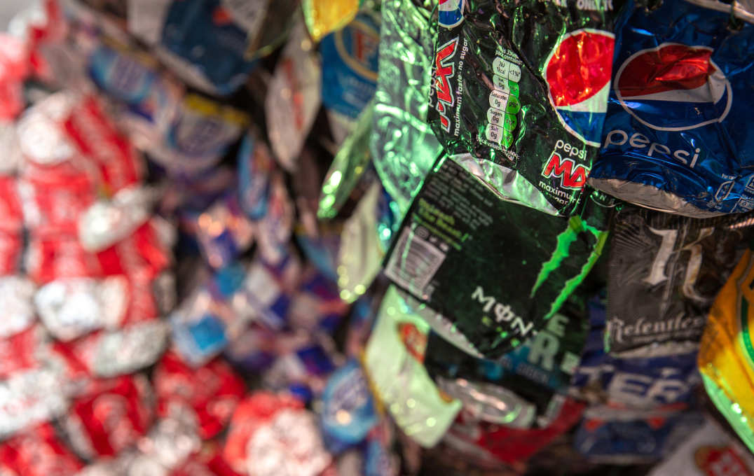 Close up of the flattened cans, reading Monster, Pepsi, Pepsi Max