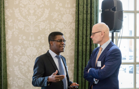 Thierry zomahoun talks with Professor Ian Walmsley