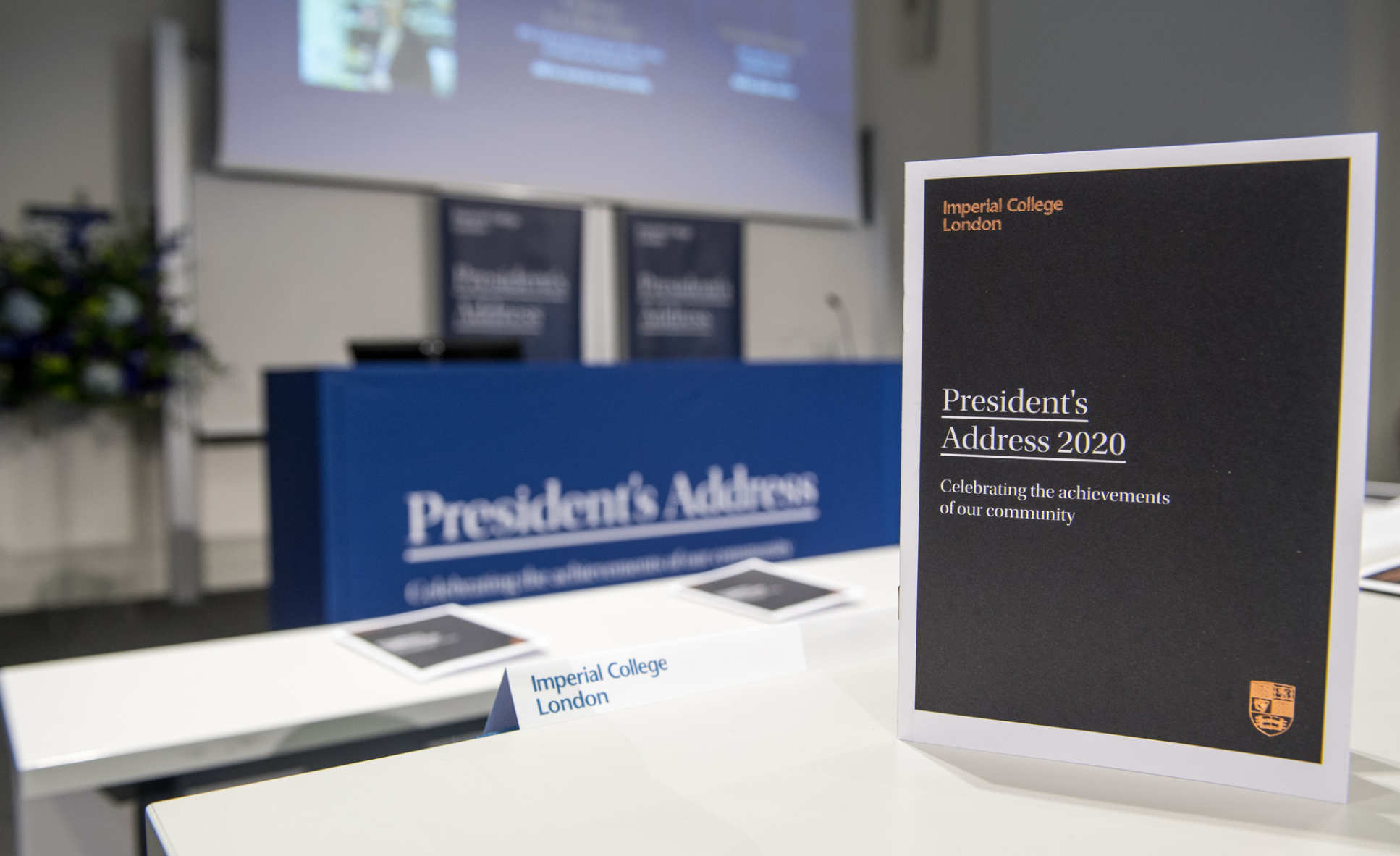 A lecture theatre set up for the 2020 President's Address, with a copy of the event programme showing the Imperial crest in the foreground
