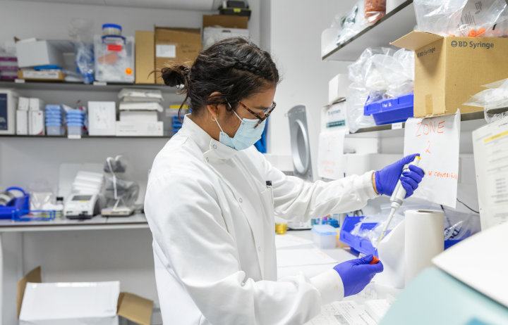 woman in lab coat working in lab