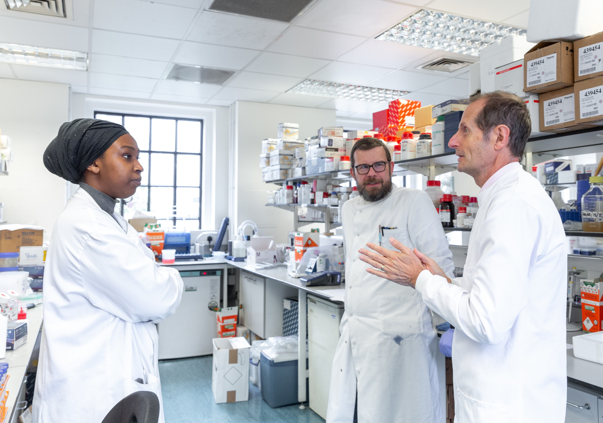 Robin Shattock and colleagues in lab