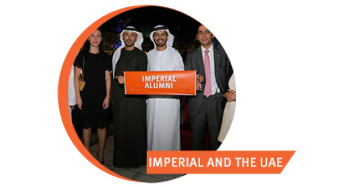 Four alumni at an event in Dubai
