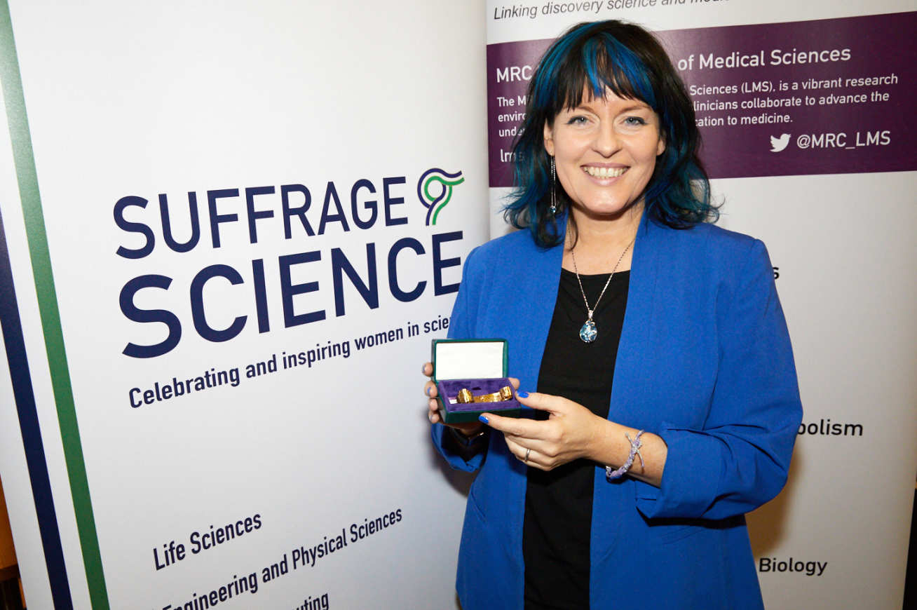 Professor Julie McCann with her award