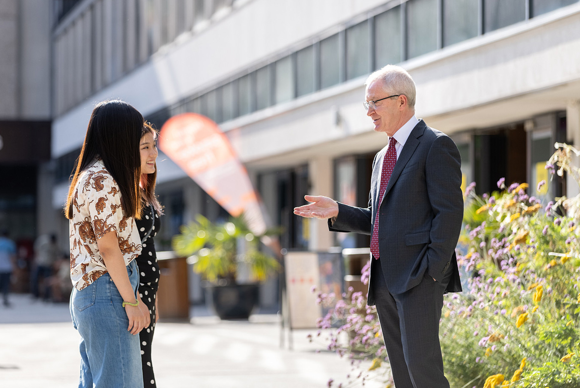 Professor Hugh Brady talking to students on campus