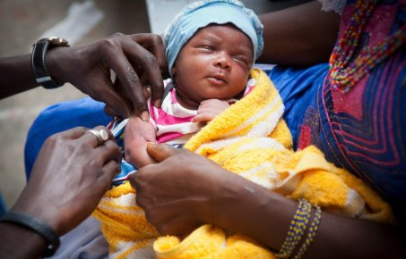 A baby receiving an injection
