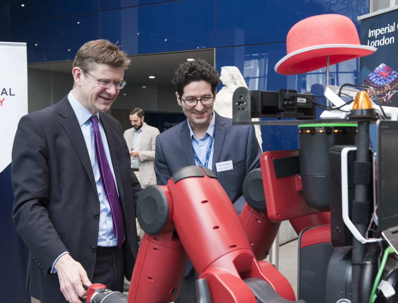 Business Secretary Greg Clark interacting with robot named Robot DE NIRO at Imperial.