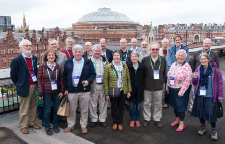 A group of physics alumni with the Royal Albert Hall in the background