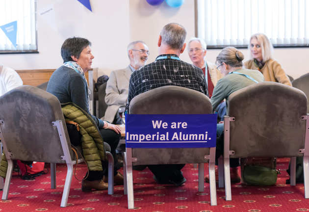 Alumni chatting at a departmental reception