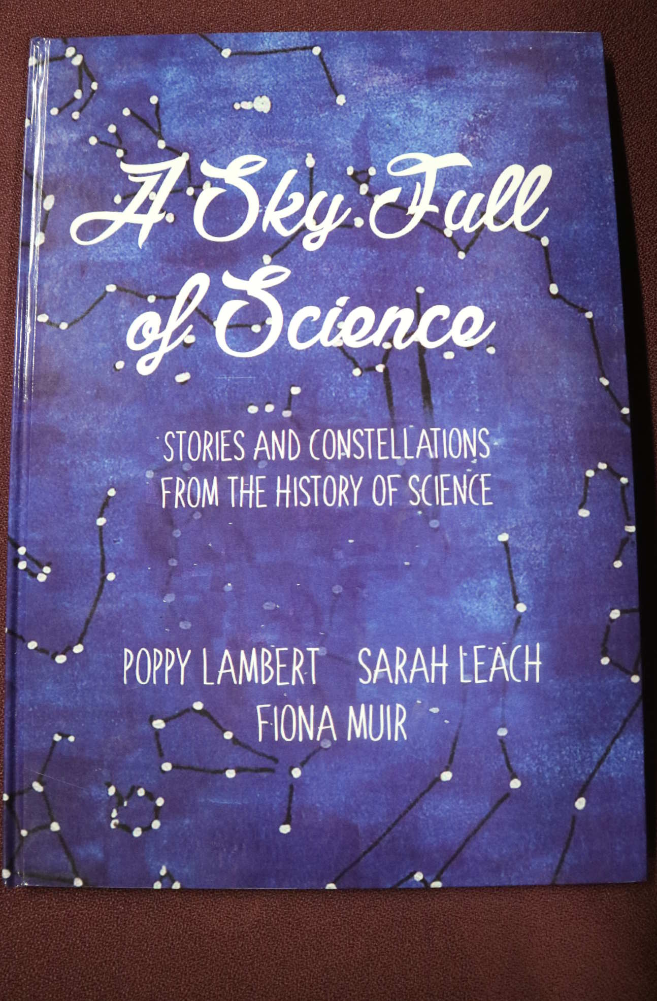 A book with the title 'A sky full of science'