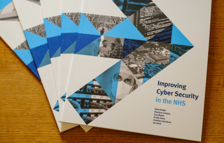 A photograph of our printed report on cyber security