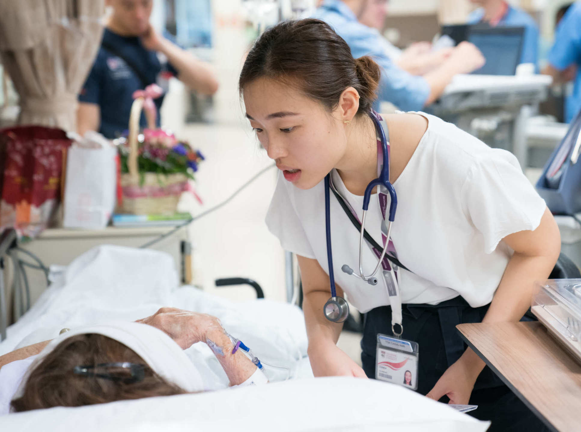 LKCMedicine graduate Ching Han checks on a patient